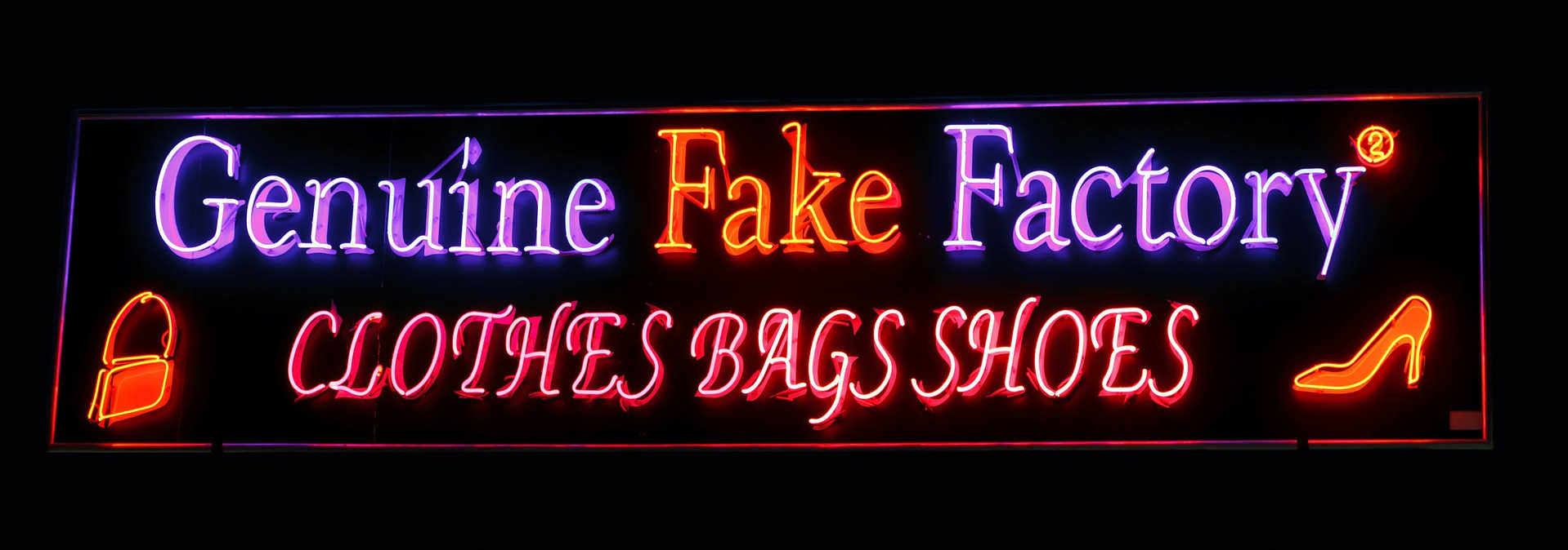 A neon sign advertising fake items, representing the influence of using fake items on unethical behavior.